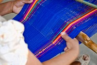 Close_up of a woman weaving textile, Santo Tomas Jalieza, Oaxaca State, Mexico