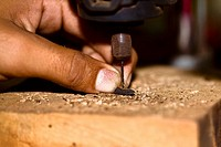 Close_up of a person's finger drilling, Izamal, Yucatan, Mexico