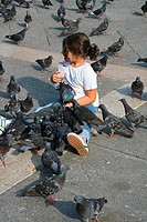 Venice - girl between doves (thumbnail)
