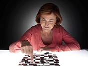 Woman playing checkers