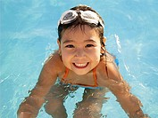 Young girl in swimming pool portrait, high angle view