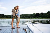 Couple standing on pier