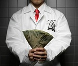 Doctor Holding US Dollars