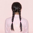 Woman´s back with braids
