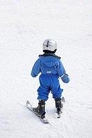 Little girl is skiing