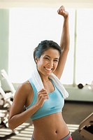 Eurasian woman cheering in health club
