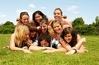 Portrait of a group young people on lawn