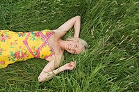 Smiling woman lying in field