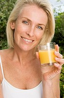 Portrait of woman with orange juice