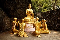 Statue of Buddha and monks in Luang Prabang, Laos, 2008