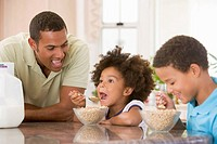 Children Eating Breakfast With Dad