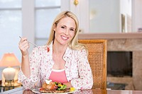 Woman Enjoying Healthy meal,mealtime