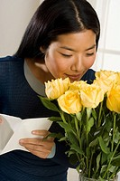 Woman smelling bouquet of roses