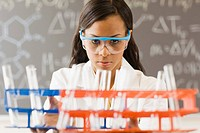 College Chemistry Student With Test Tubes