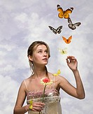 Young woman with flower and butterflies