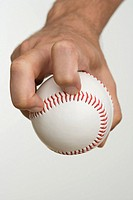 Close up of pitcher holding baseball
