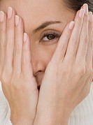 Close up of woman covering face with hands