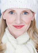 Close up of woman wearing hat and scarf