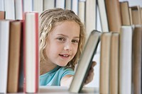Girl looking at books on shelf