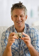 Man looking at digital camera