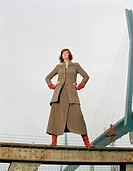Woman standing on steel girder