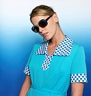 Woman with light blue dress and sunglasses, portrait