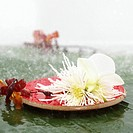 Blossoms on wooden plate, close_up