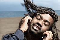 African man listening to headphones