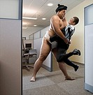 Pacific Islander sumo wrestler lifting businessman in office