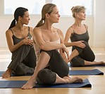 Multi_ethnic women practicing yoga