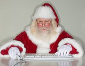 Santa Claus typing on computer