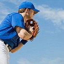 Baseball pitcher preparing to pitch ball