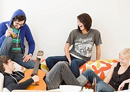Group of friends relaxing on sofa