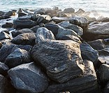 Rocks in front of water