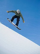 Man on snowboard in air