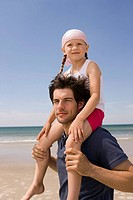 Germany, Baltic sea, Father carrying daughter 6 on shoulders, portrait