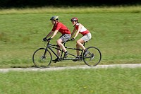 Germany, Bavaria, Oberland, Couple mountain biking on tandem