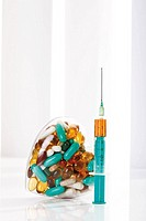 Syringe and pills, close_up
