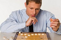 Businessman playing Chinese chess