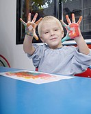 Boy finger_painting in classroom