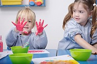 Girls finger_painting in classroom