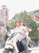Couple riding on scooter