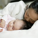 Mother and baby daughter sleeping