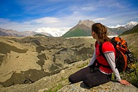 Woman looking out across the Root Glacier moraine near Kennicott in Wrangell_St.Elias National Park, Alaska