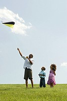 Father and children with kite