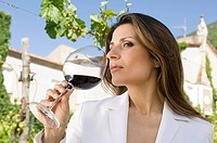 Woman smelling wine