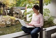 Student in japanes garden