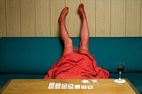 Woman lying upside down on a sofa (thumbnail)
