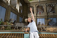 Girl in a museum with stuffed animals