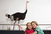 Two children with ostrich at museum